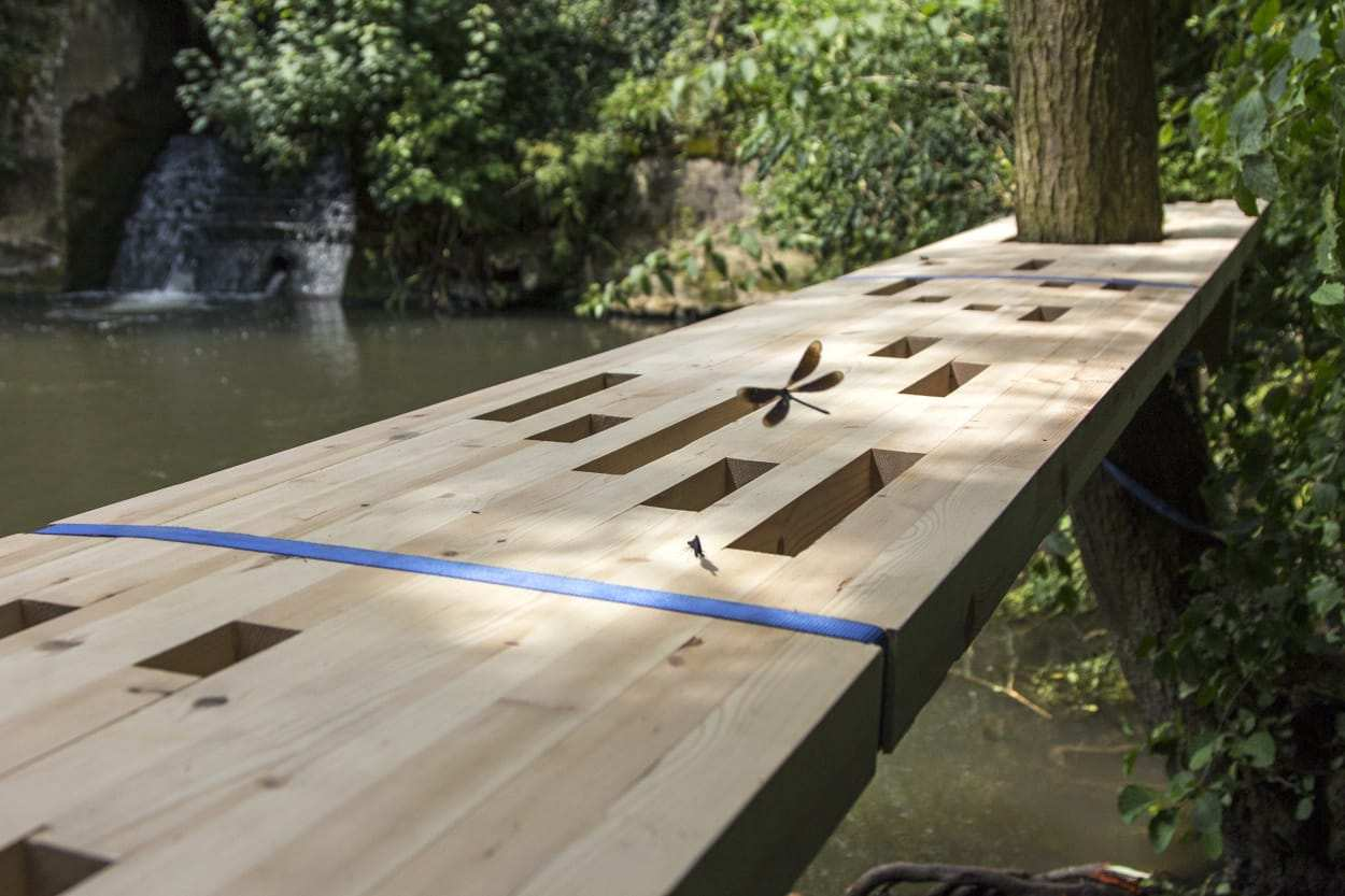 wood_building_designers_holiday_pond_water_bridge